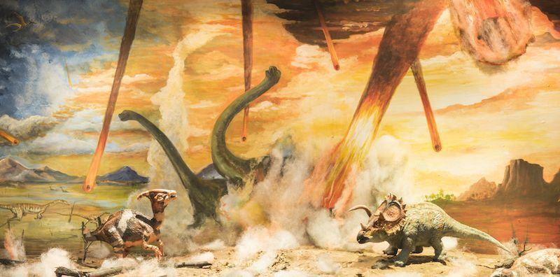 Dinosaurs escaping from a big meteorite crash. By MK photograp55 | Shutterstock.com